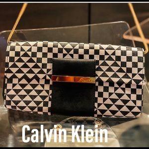 Calvin Klein checker saffiano leather clutch.